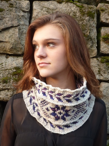 Young woman wearing snowflake colorwork cowl